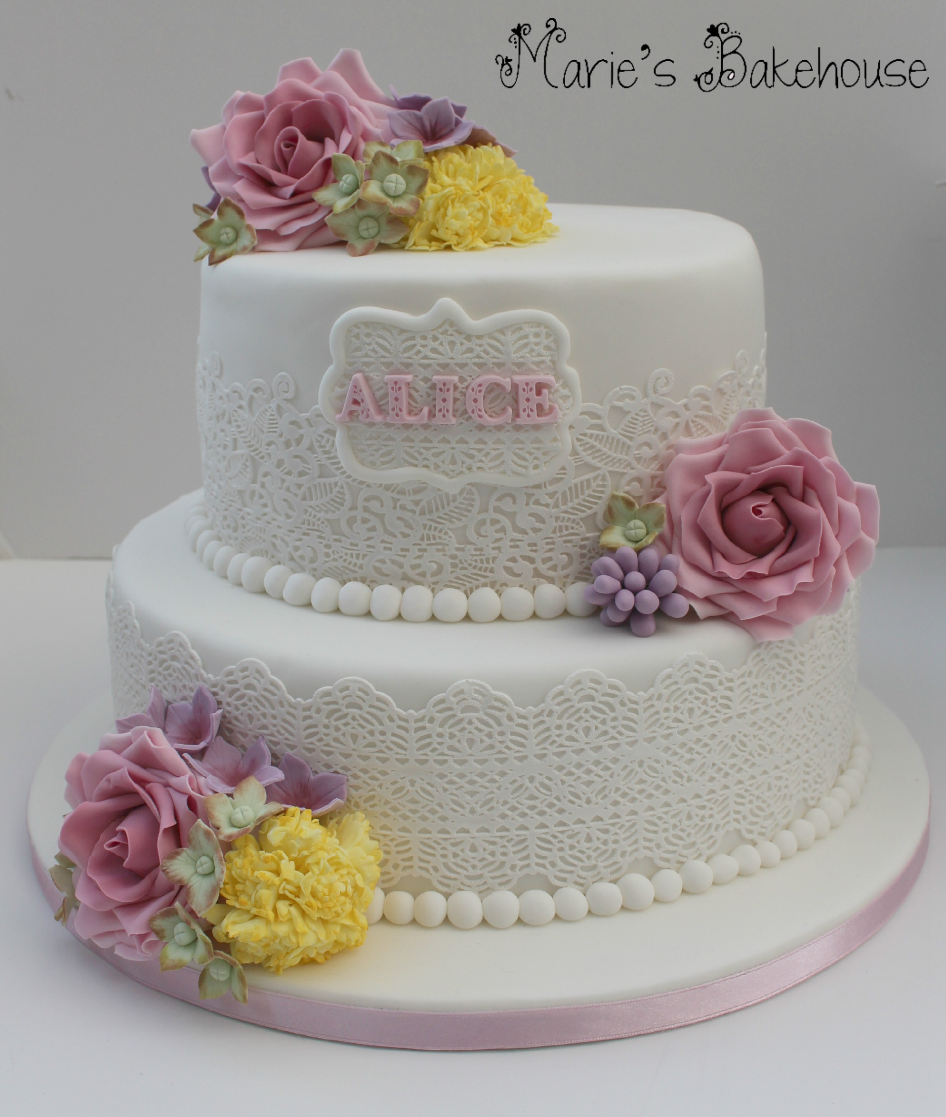 90th birthday cake with sugar flowers and edible lace