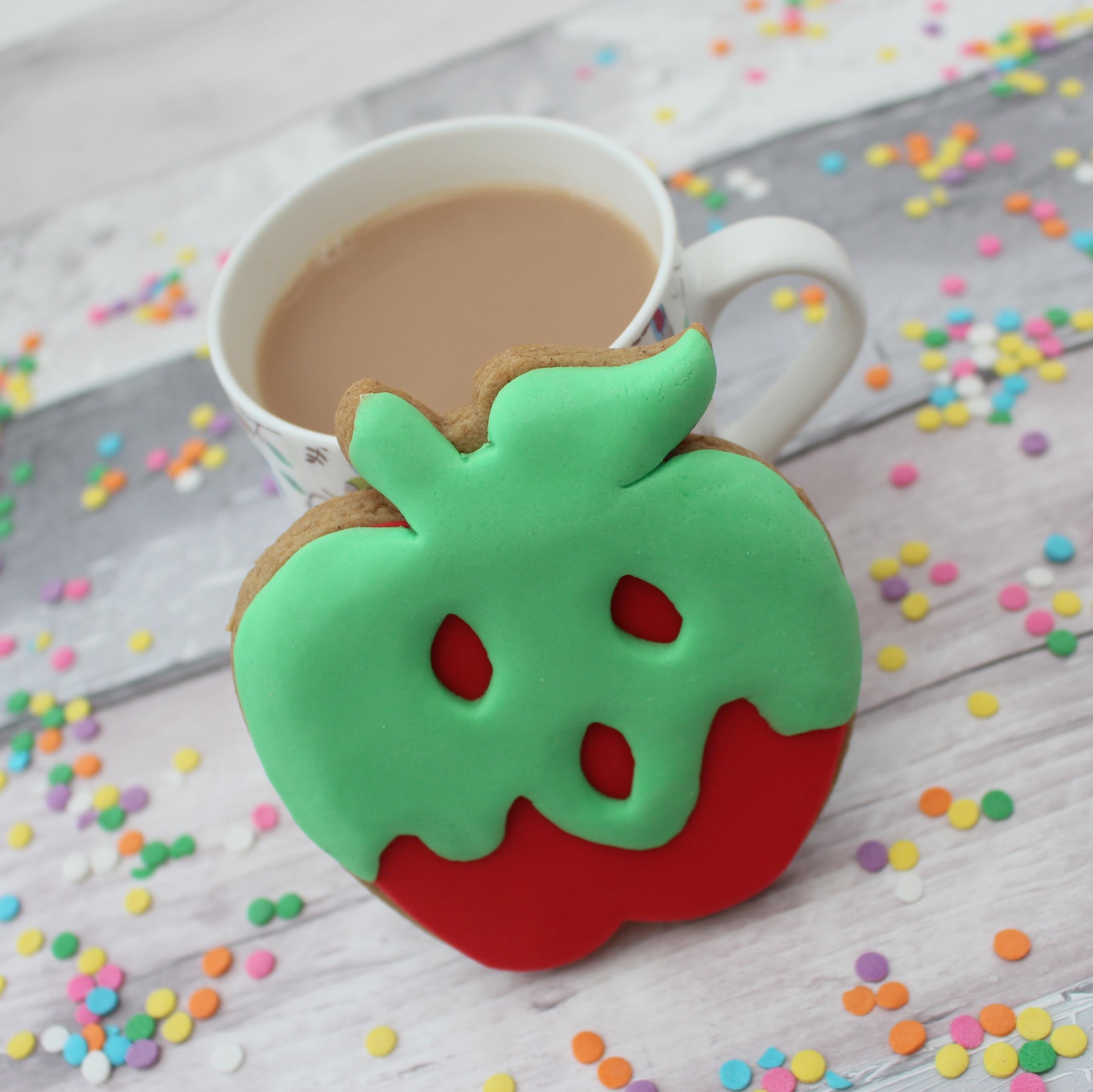 poison apple themed cookie