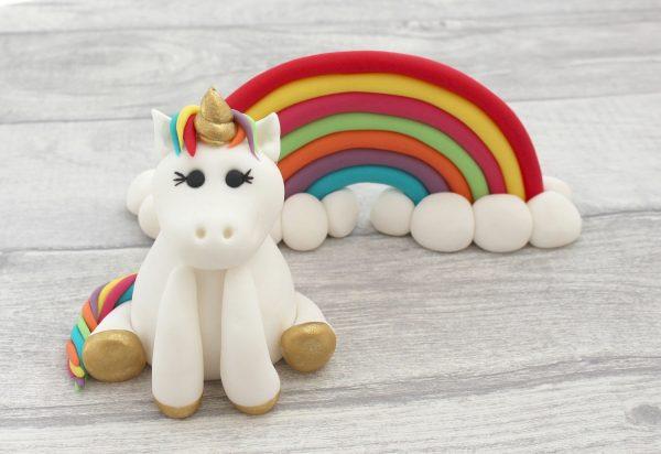 bright coloured unicorn cake topper